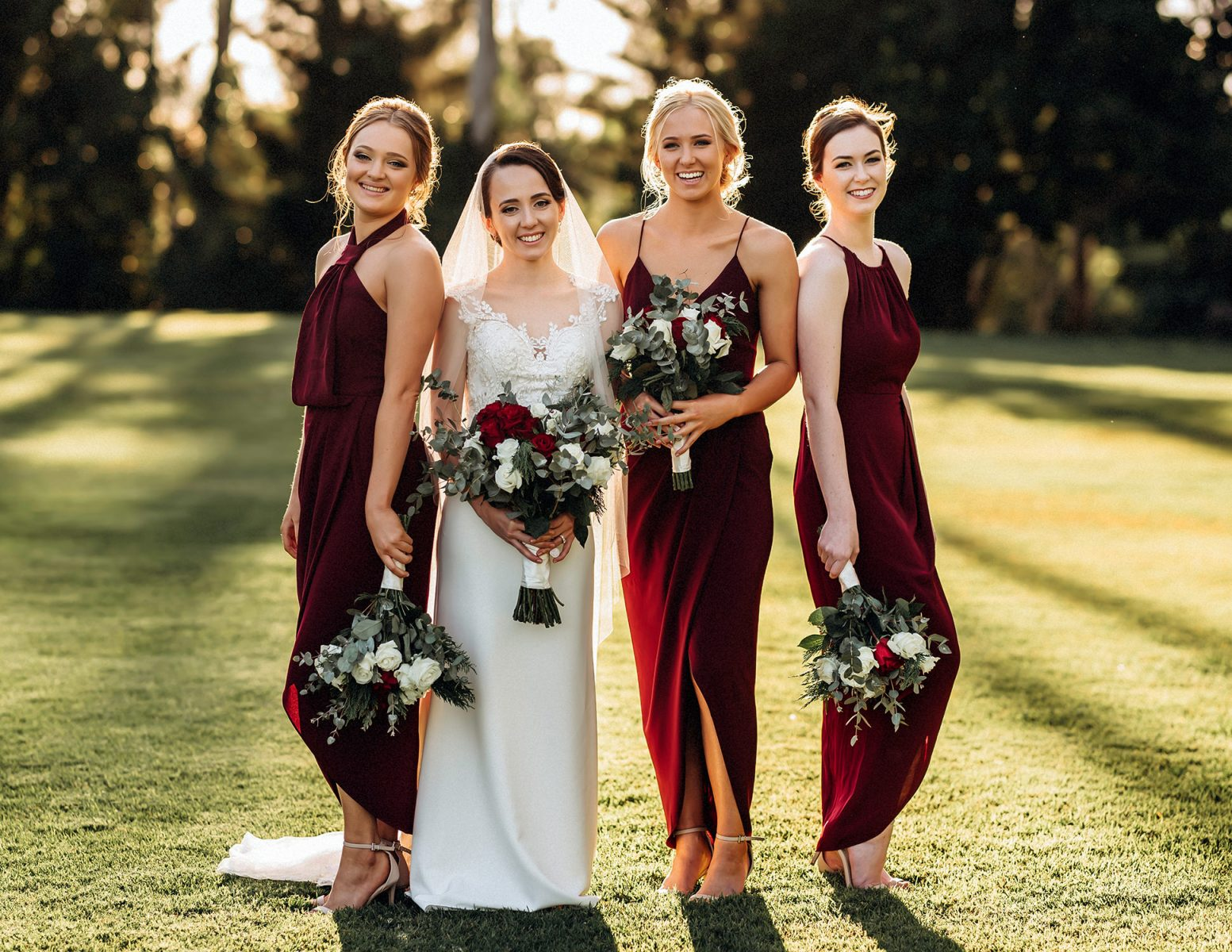 Bride with Bridesmaids holding bouquets.