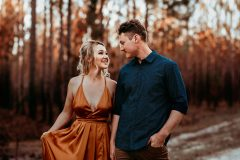 Bundaberg Engagement Session: Couple holding hands while walling through the forest.