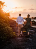 couple walking into a beach sunset