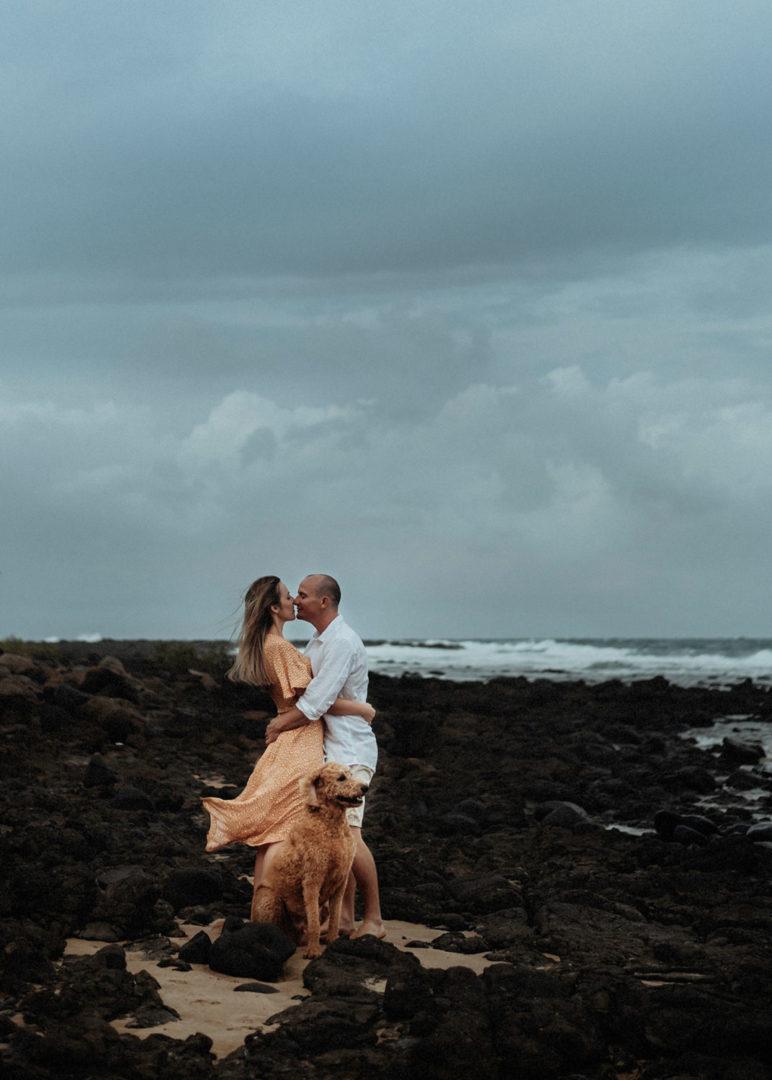 windy beach engagement photo