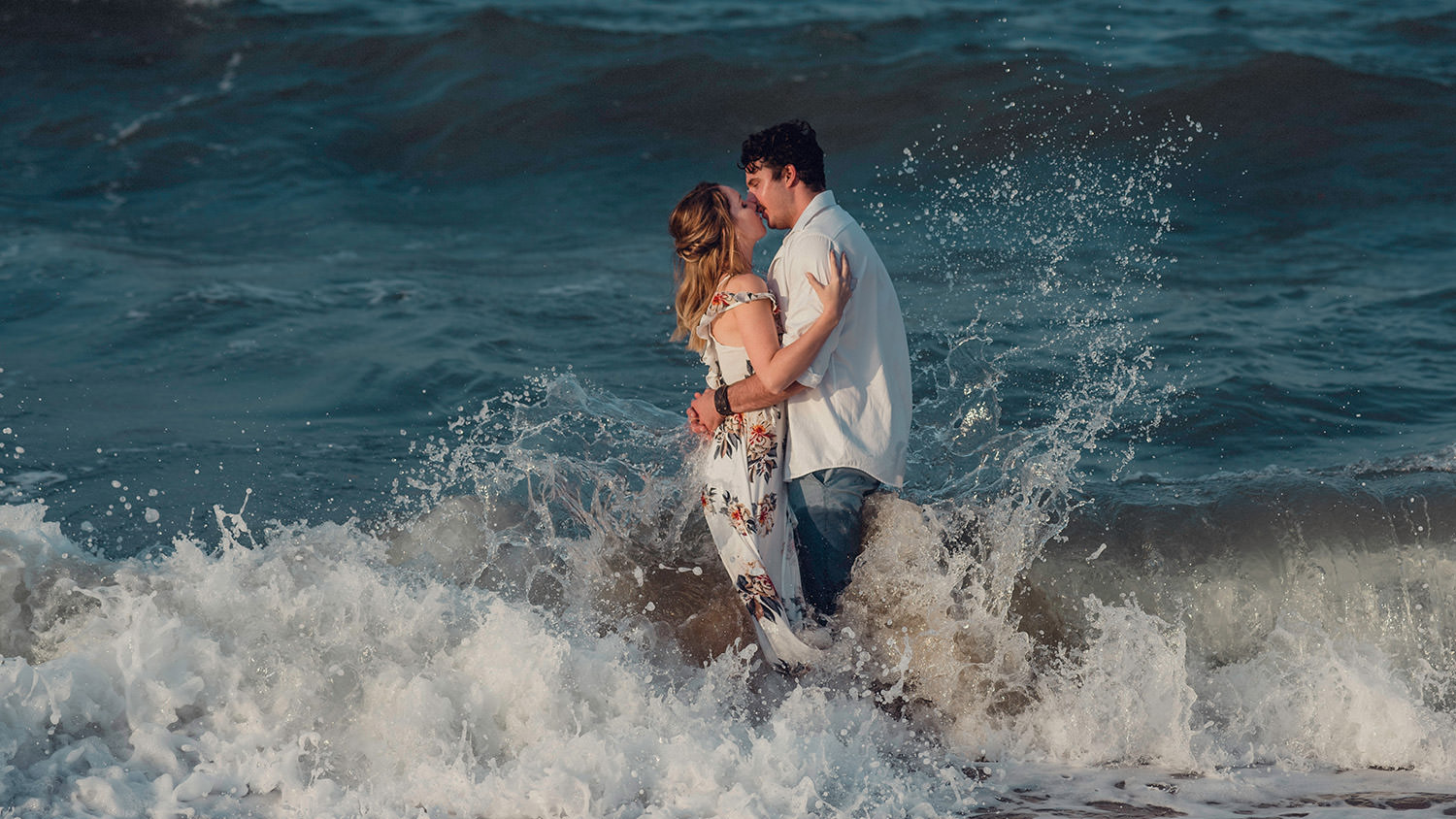 engaged couple in the water