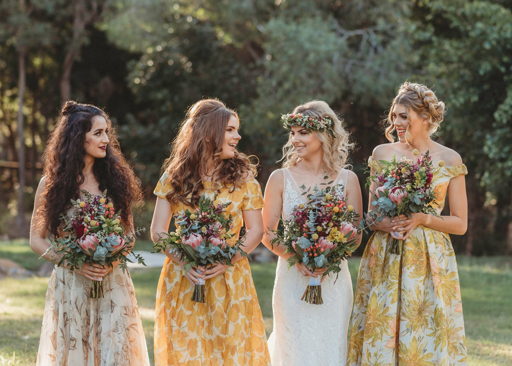 Girls wearing vintage dresses and carrying beautiful bouquets