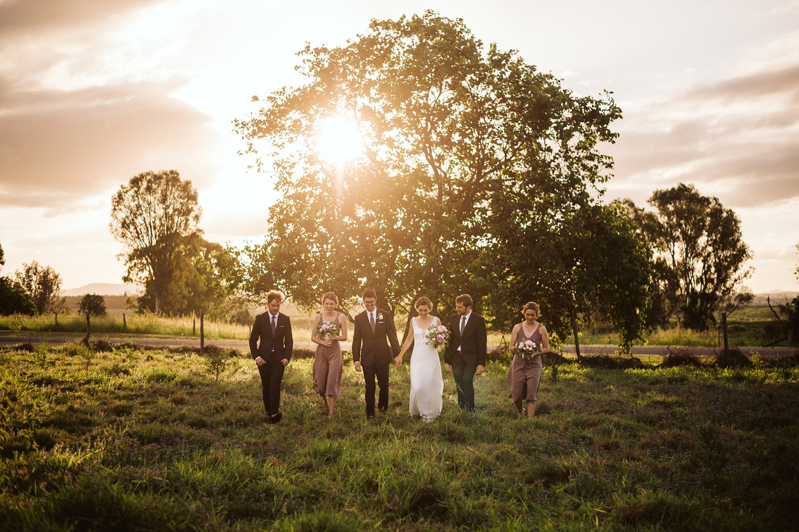 Bridal Party walking at Sunset