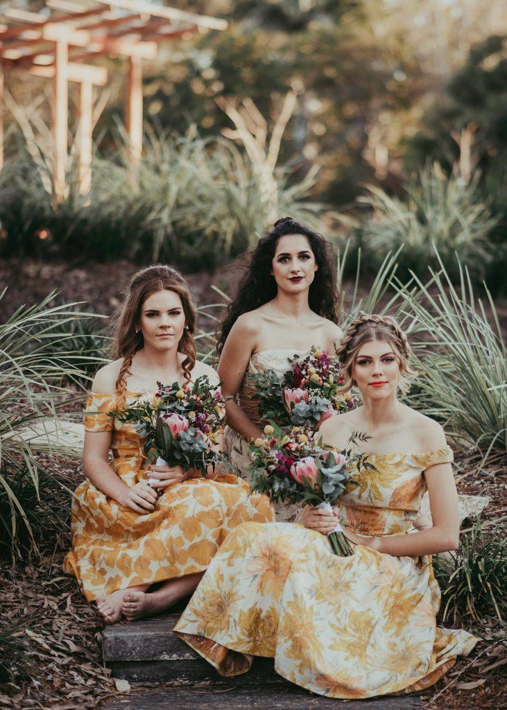 three girls in vintage dresses