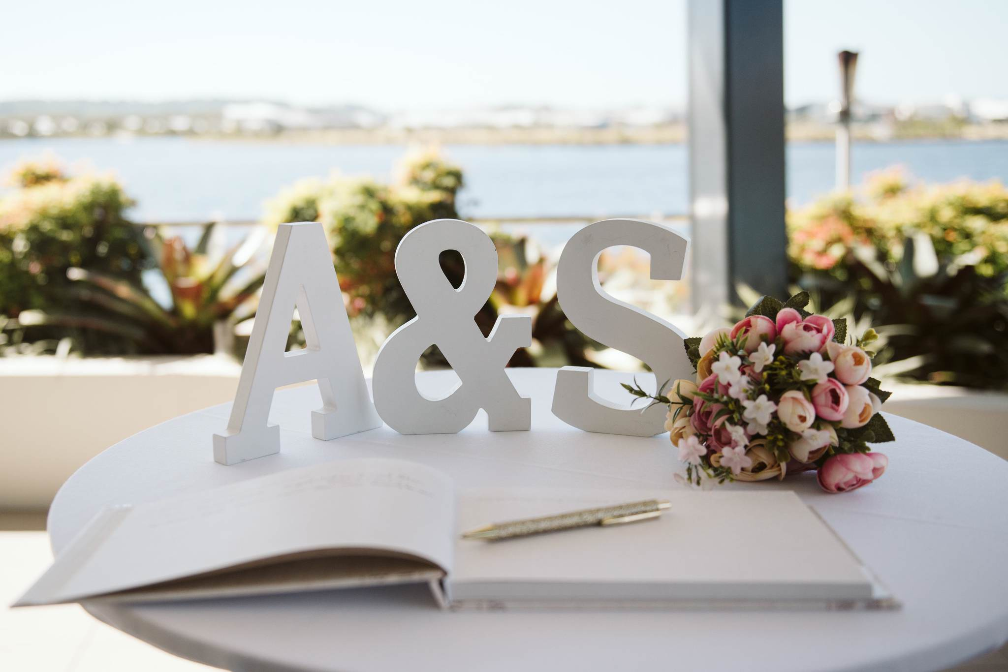 Wooden Initials on a table with guest book
