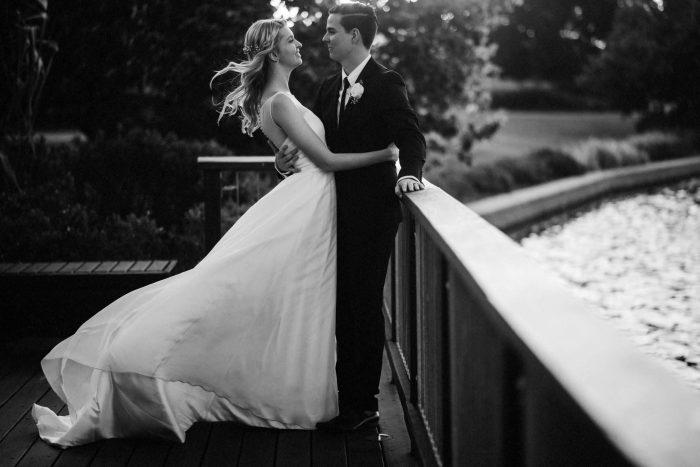 Couple standing near a lake