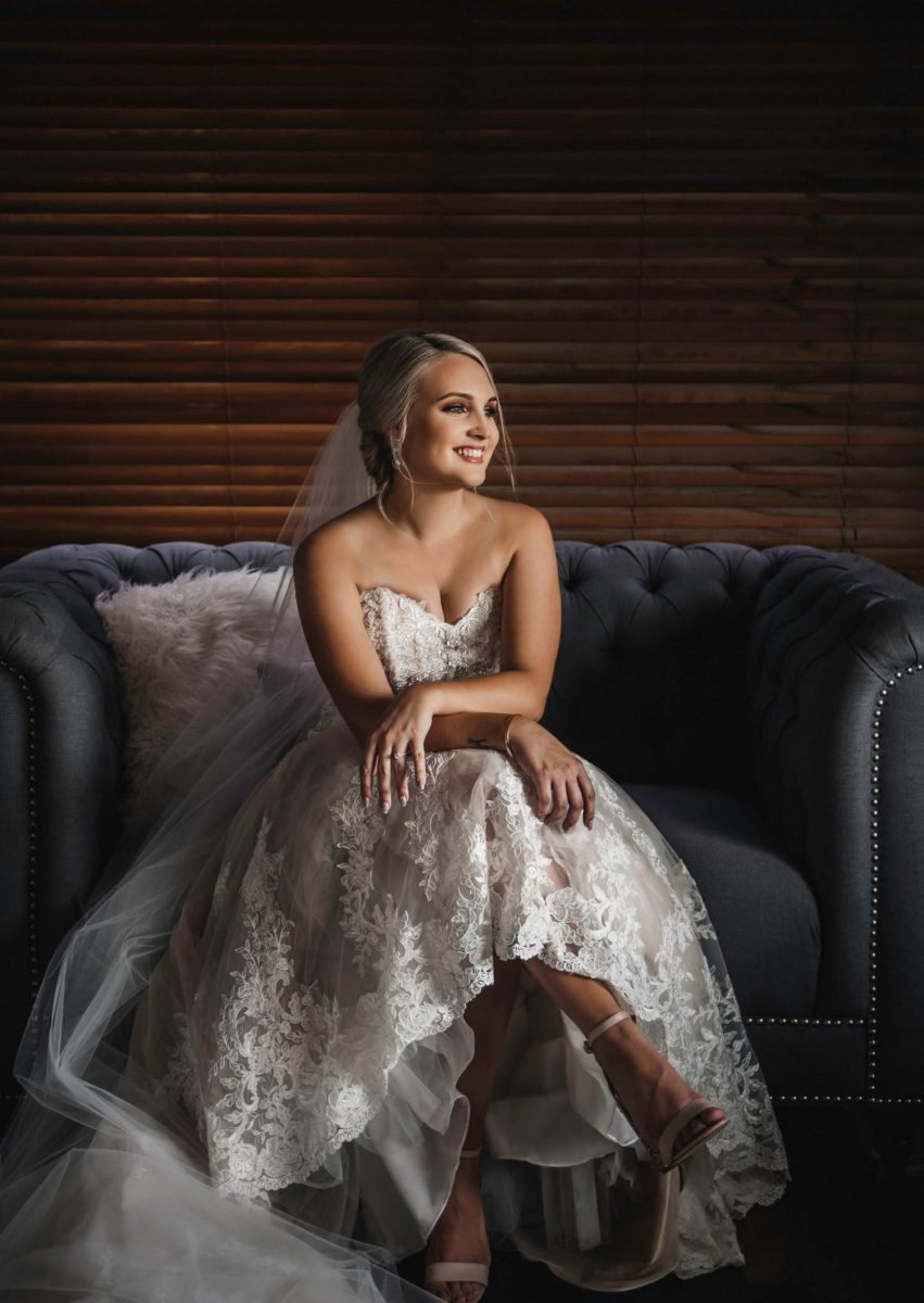 Bride sitting in lounge chair