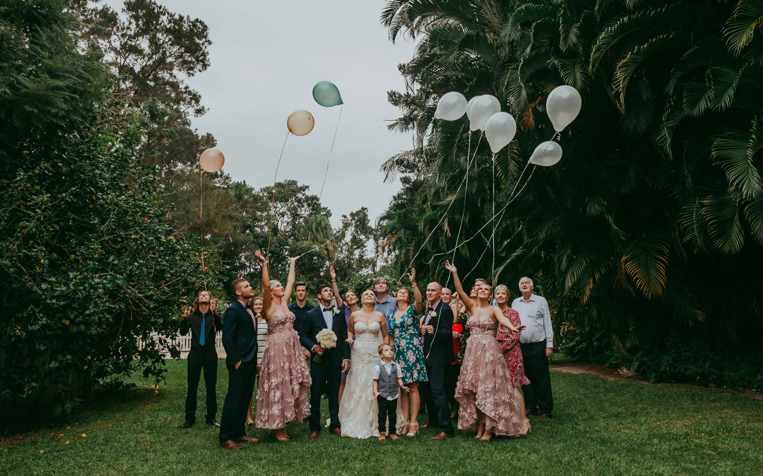 Wedding guests releasing balloons