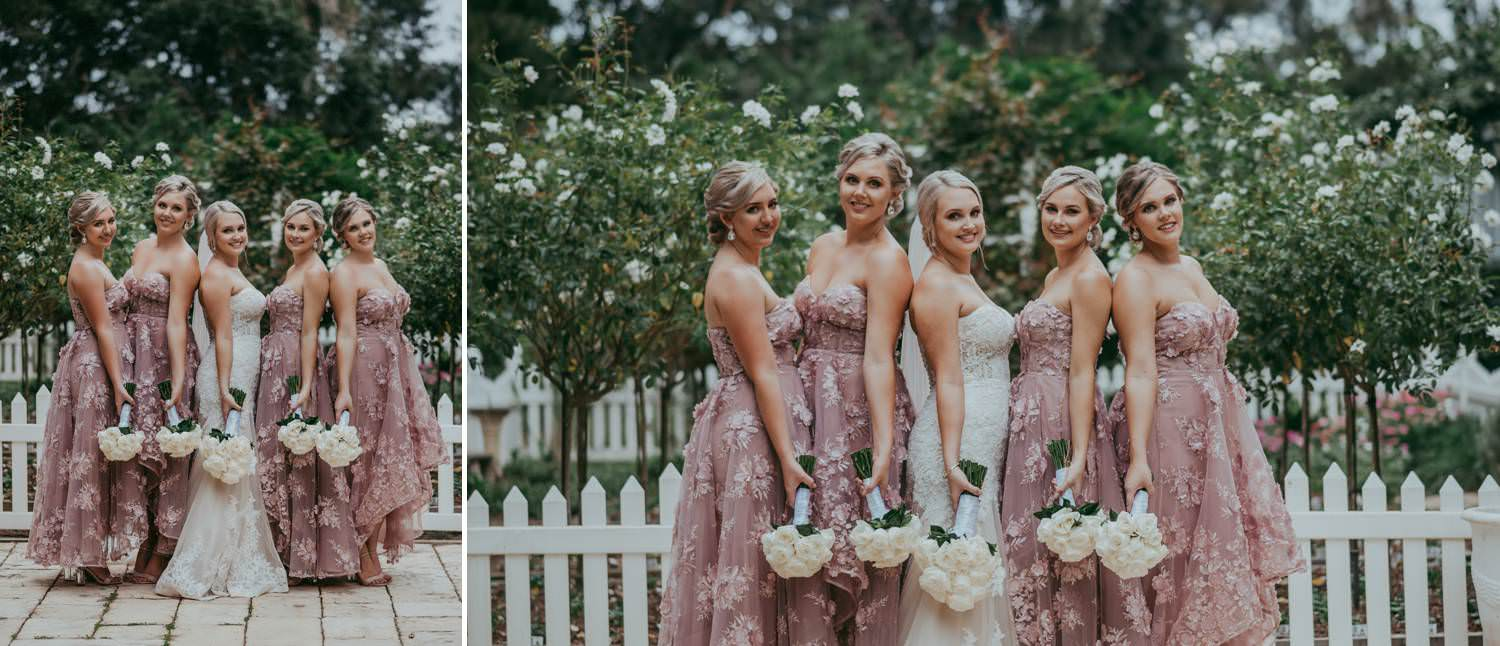 Bride and her bridesmaids in pink dresses.