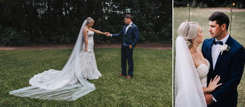 Bride and groom standing in open field