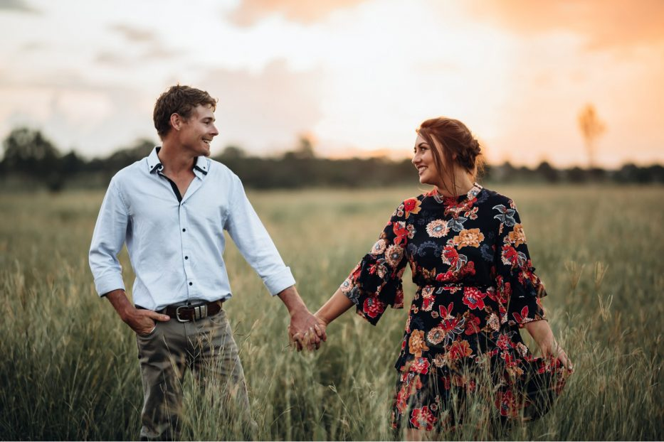 Couple Holding Hands in long grass