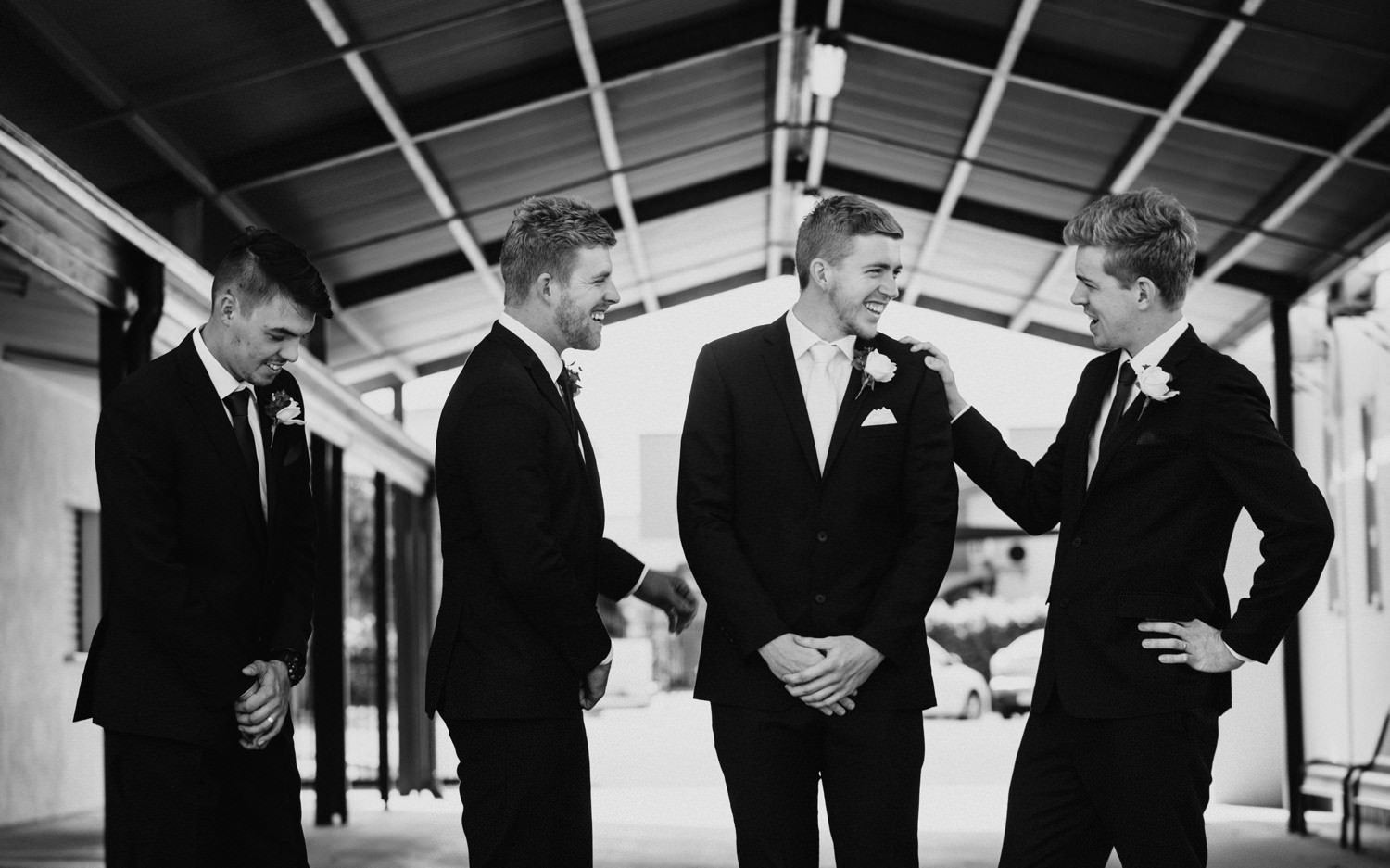 Grooms men talking before the ceremony