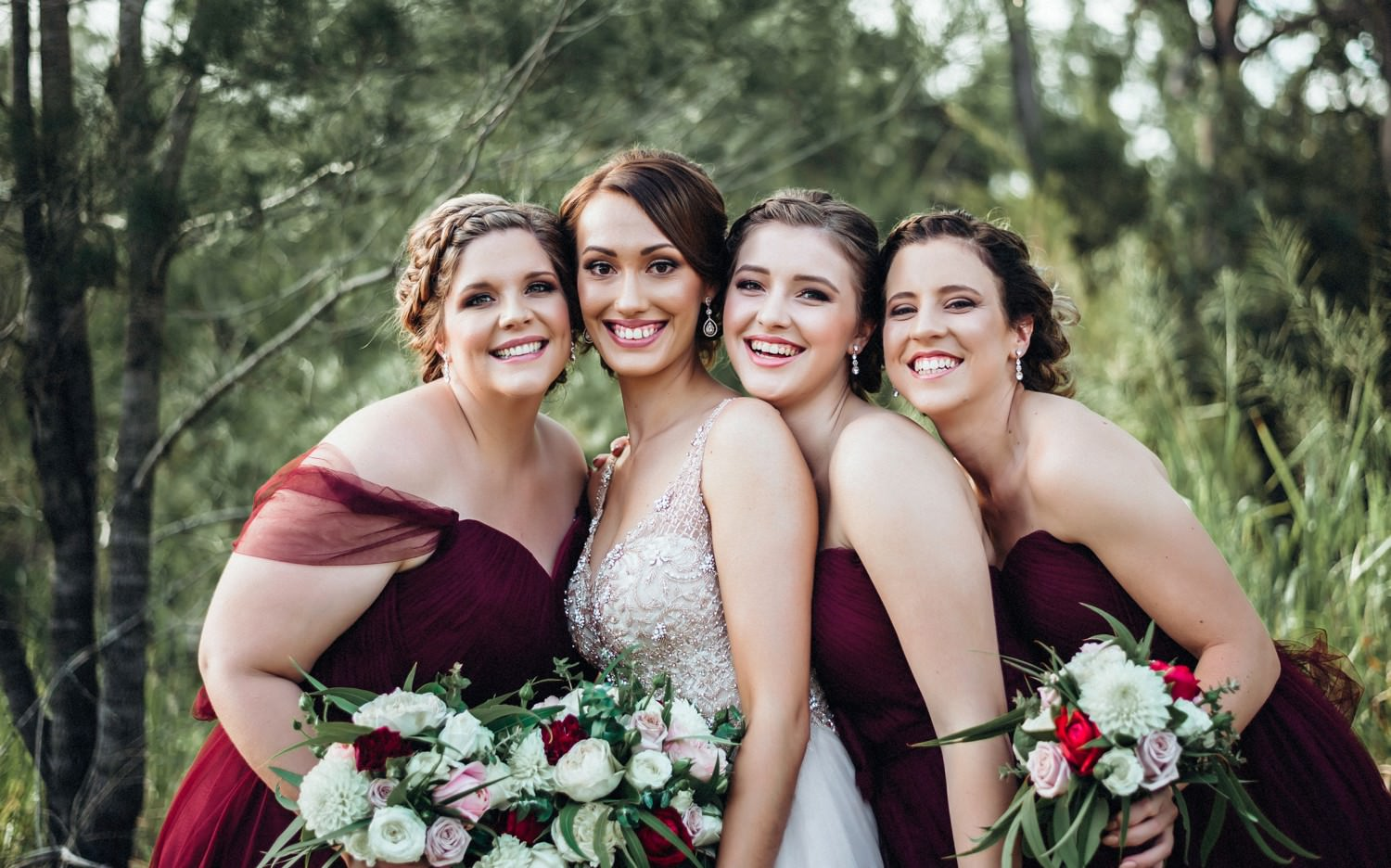Bride with Bridesmaids wearing merlot colour dresses