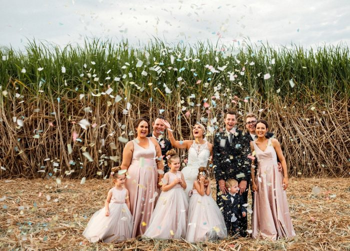 Wedding Party in a Cane field with confetti