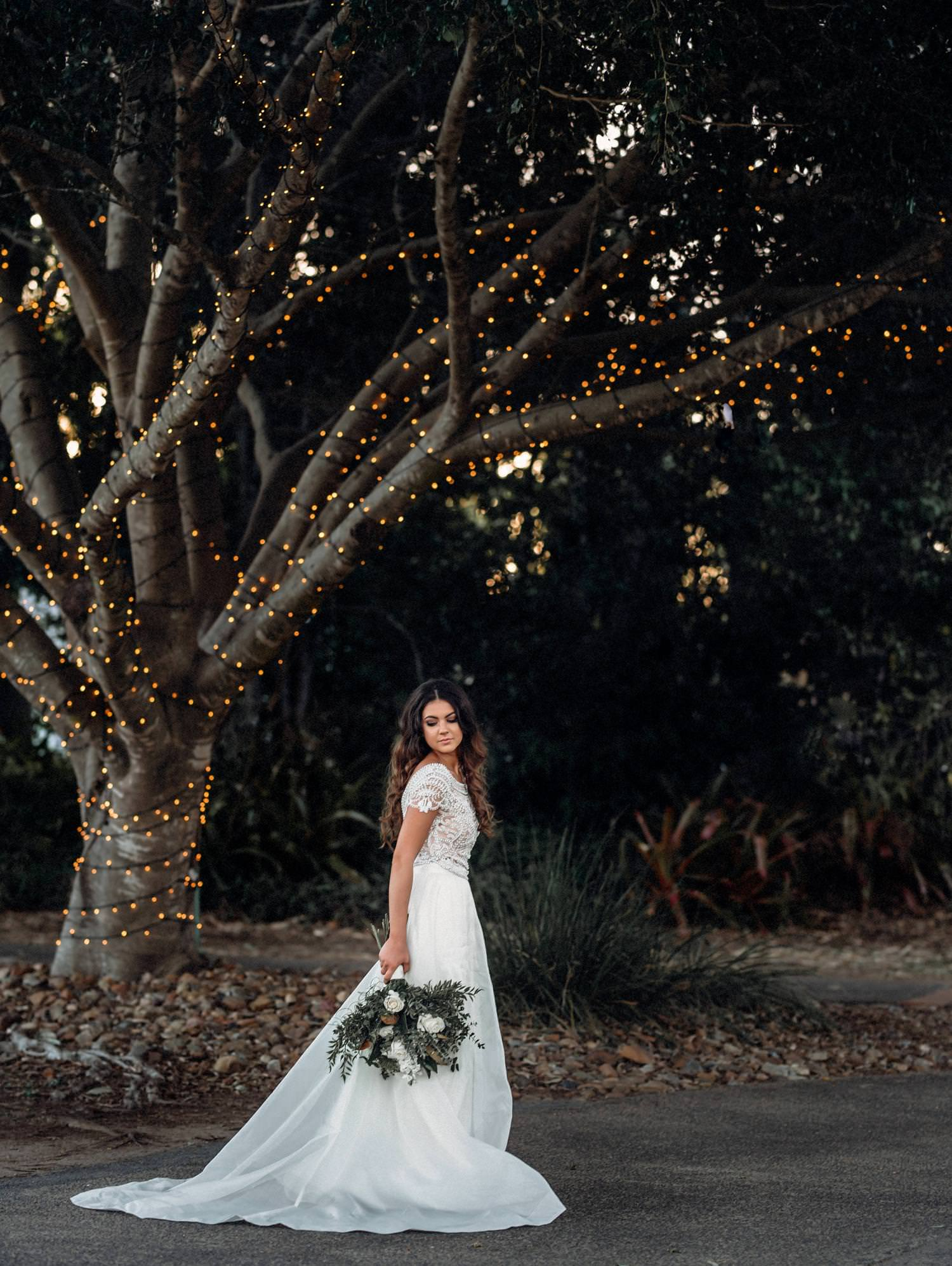 Bride under tree with Fairy light