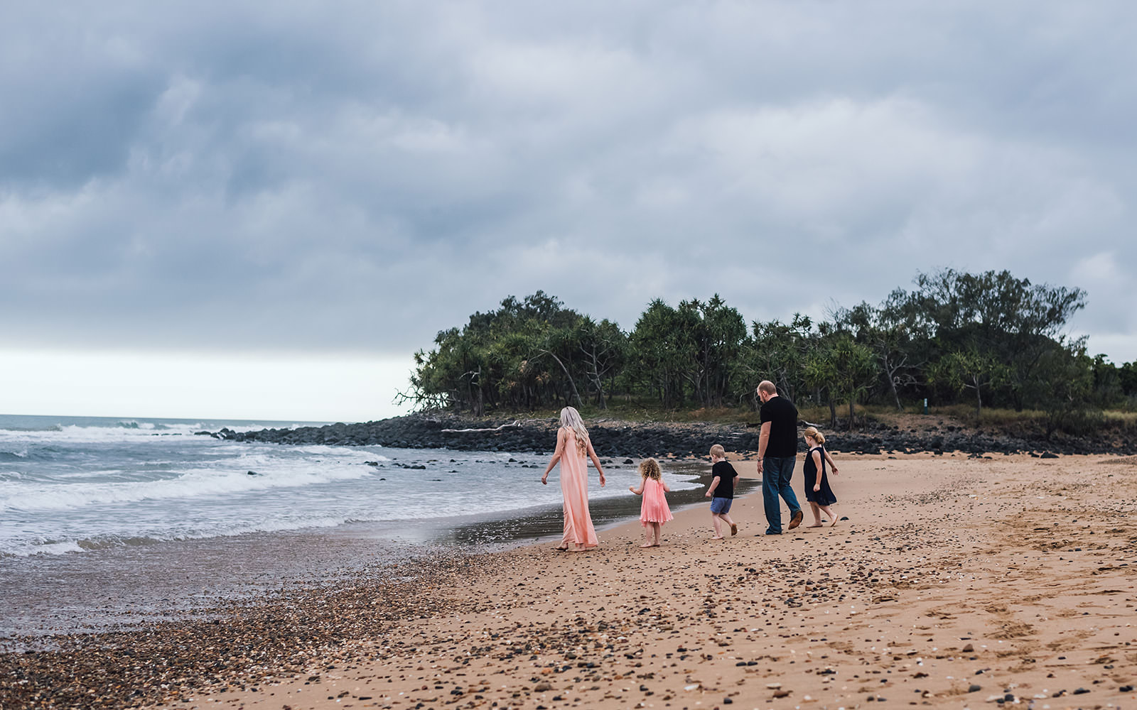 Family walking towards the water at Mon Repo beach , Bundaberg.