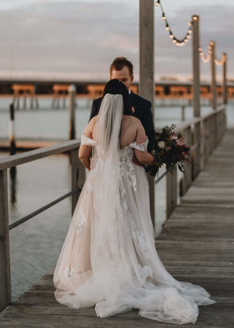 wedding couple on dock Sandstone Point, QLD