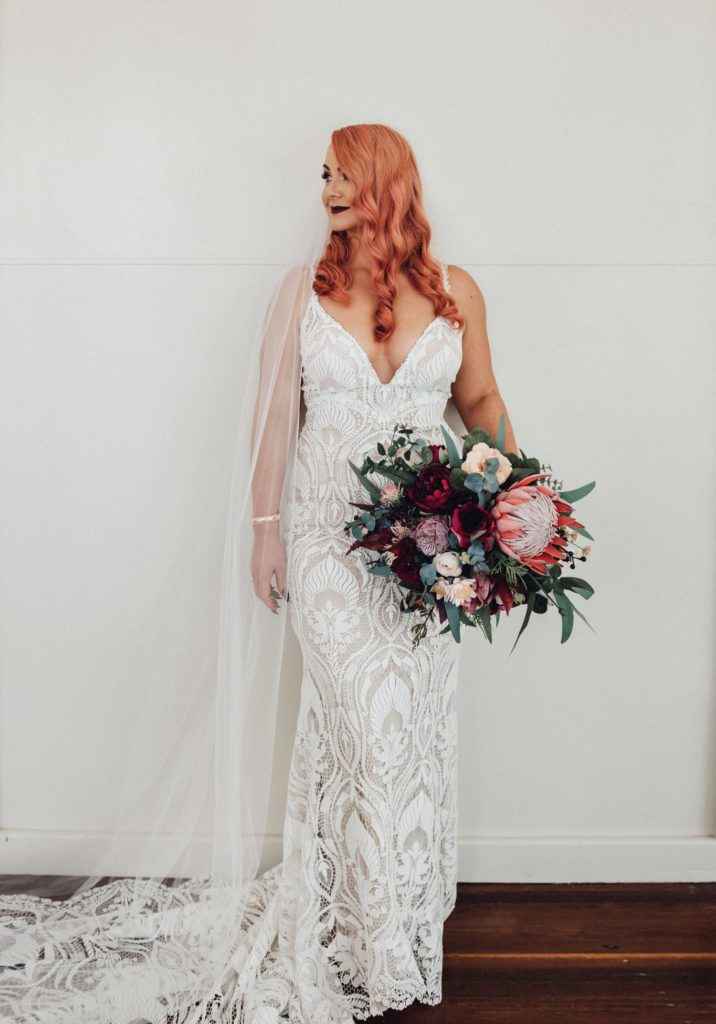 Bride in white with flowers