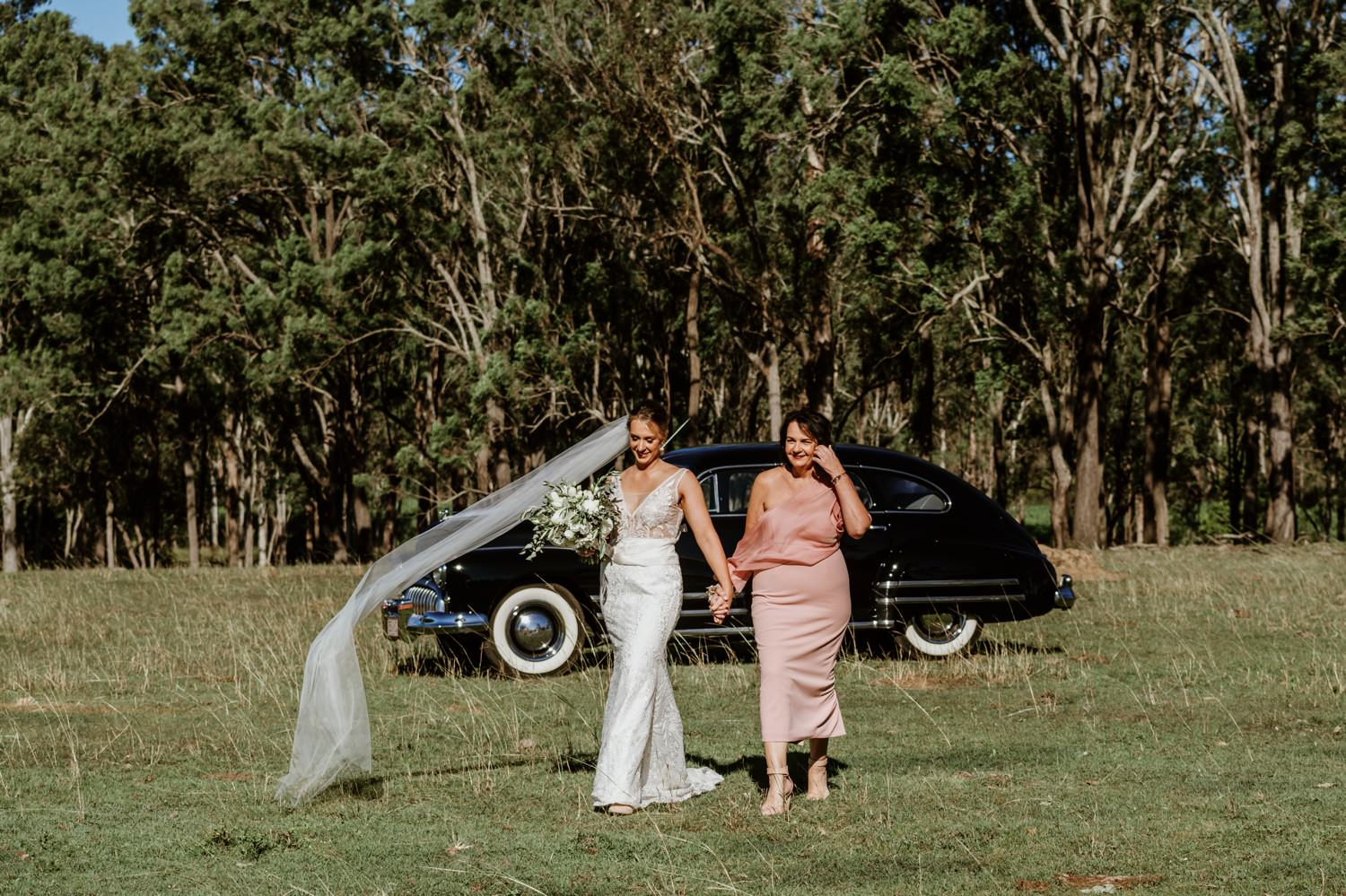 mother and daughter walking down aisle