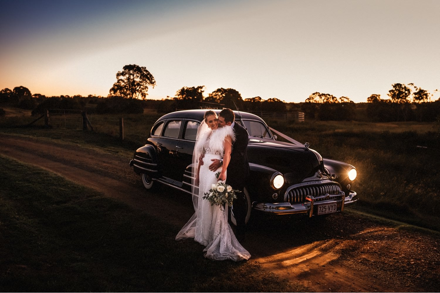 couple at dusk with vintage car