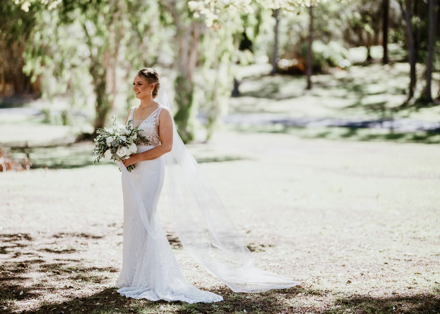 Bride with veil and white bouquet