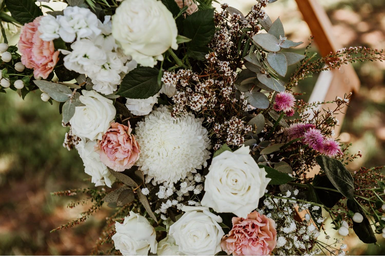 wedding flowers on decorative arch