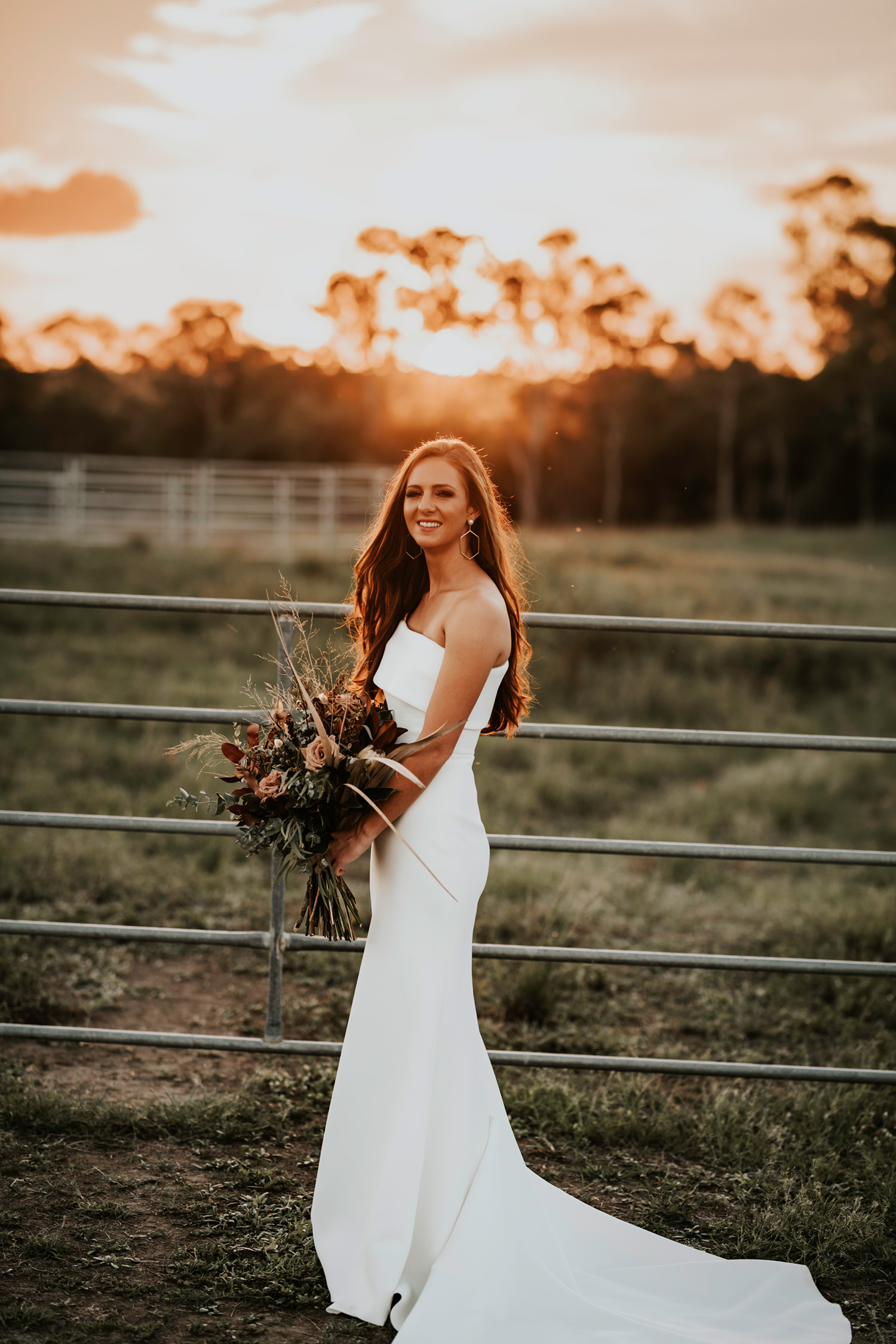 Bride at cattle yards at sunset