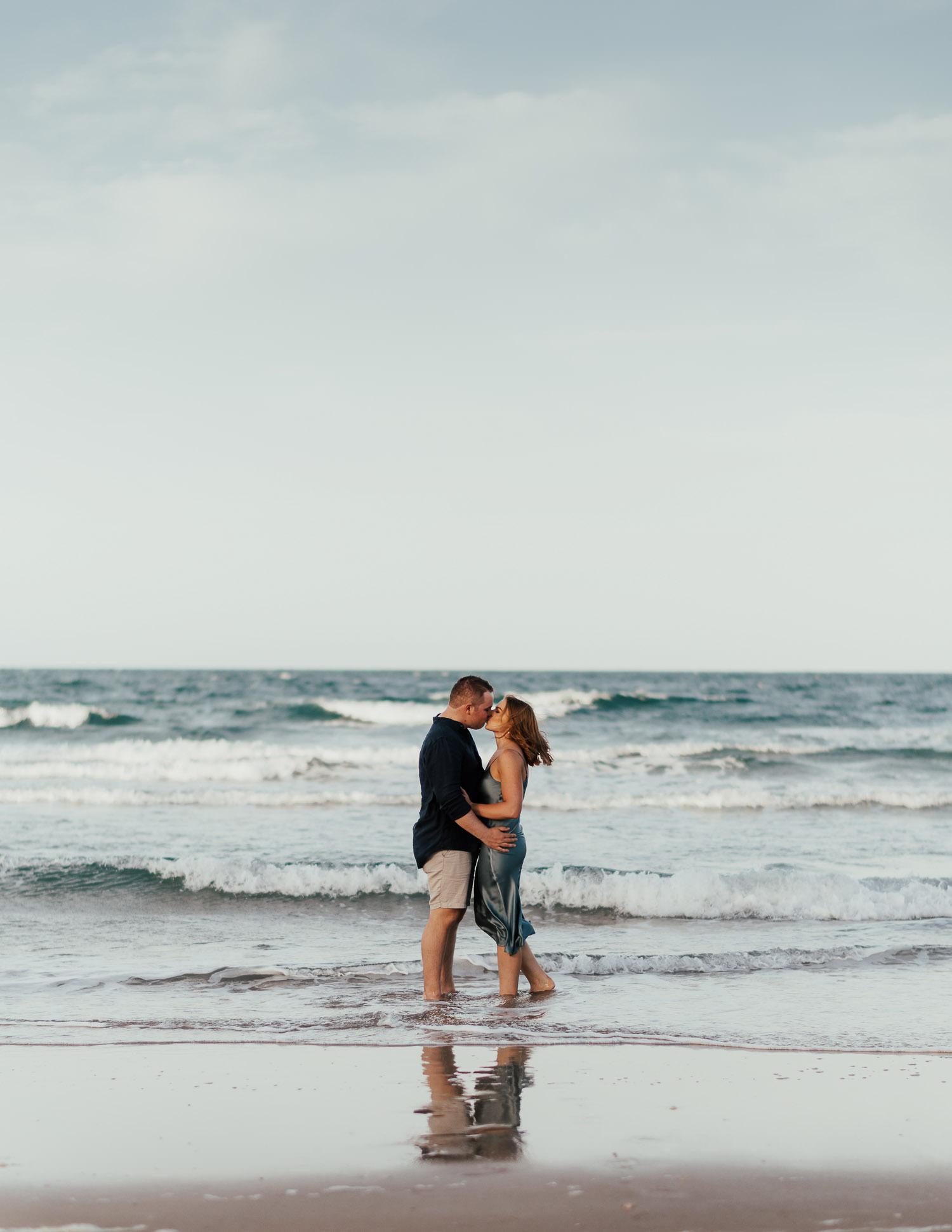 couple kissing at beach